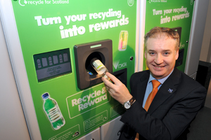 Cabinet Secretary Richard Lochhead returning a bottle to a reverse vending machine